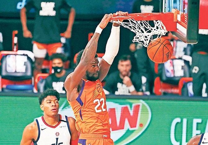 Phoenix Suns centre Deandre Ayton (22) dunks the ball as Washington Wizards forward Rui Hachimura looks on during the second half of an NBA basketball game Friday, July 31. (Kim Klement/Pool Photo via AP)