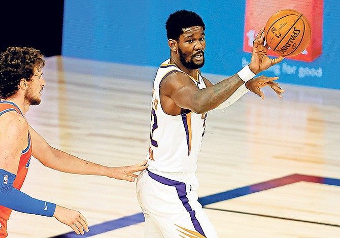 Phoenix Suns' Deandre Ayton looks to pass against the Oklahoma City Thunder during the second quarter on Monday, August 10, 2020, in Lake Buena Vista, Florida. Today, four teams - Portland, Memphis, Phoenix and San Antonio - will finally decide which two clubs get spots in the play-in series to determine the No. 8 seed in the West playoffs.  (Mike Ehrmann/Pool Photo via AP)