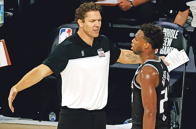 Sacramento Kings head coach Luke Walton, left, talks with Buddy Hield during the fourth quarter against the Los Angeles Lakers on August 13 in Lake Buena Vista, Florida.  (Kevin C Cox/Pool Photo via AP)