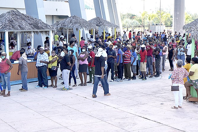 Hundreds queued at the Thomas A Robinson National Stadium last week to collect cheques from the NIB after weeks of waiting to receive funds. 