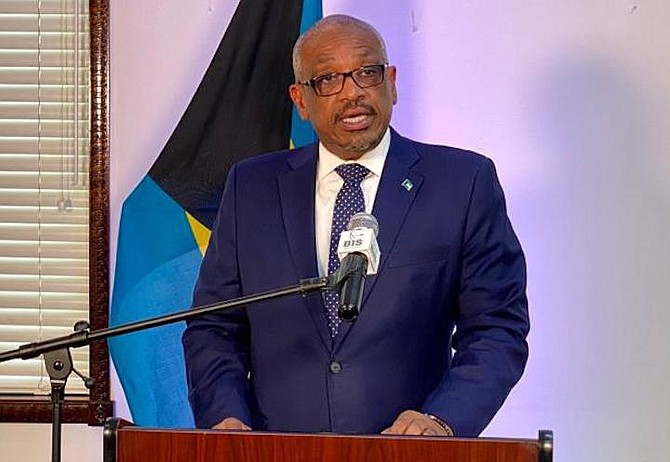 Prime Minister Dr Hubert Minnis speaking in Grand Bahama on Monday.