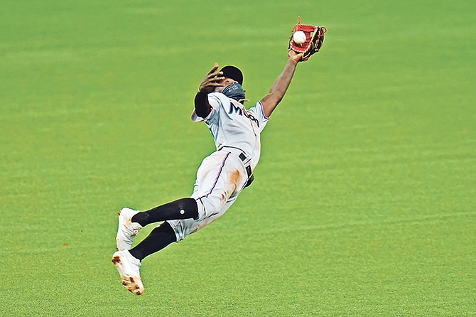 Miami Marlins shortstop Jazz Chisholm (70) makes a diving catch on a pop fly by Tampa Bay Rays' Nate Lowe during the eighth inning yesterday in St Petersburg, Florida.  (AP Photo/Chris O'Meara)