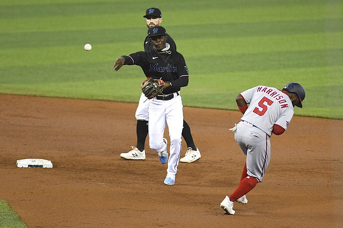 Miami Marlins shortstop Jazz Chisholm throws to first base for a double play after tagging out Josh Harrison during the first inning of a second game of doubleheader against the Washington Nationals, Sunday, Sept. 20, 2020, in Miami. (AP Photo/Gaston De Cardenas)