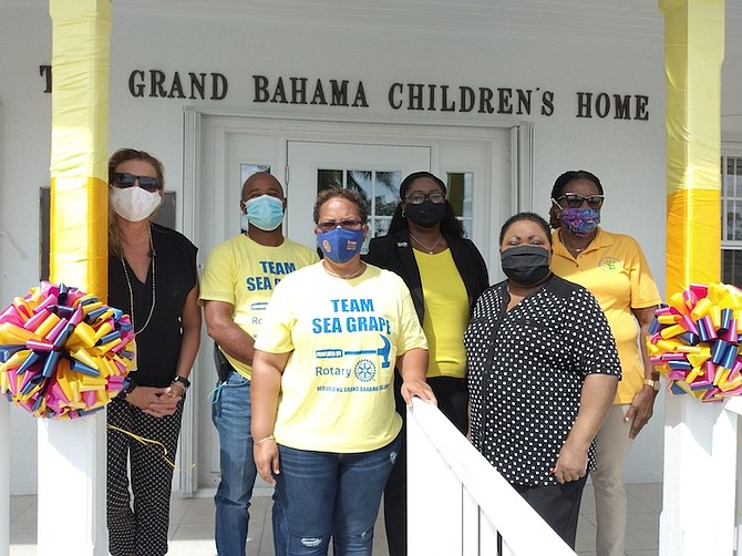 From left, Sarah Kirkby, board member of Grand Bahama Children's Home; Darren Cooper, assistant area governor of Rotary District 6990; Billy Jean Ferguson, area assistant governor District 6990; attorneys Hadassah Swain and Jethlyn Burrows of FIDA, and Sheila Johnson-Smith, executive director of GB Children's Home.Photo:Denise Maycock