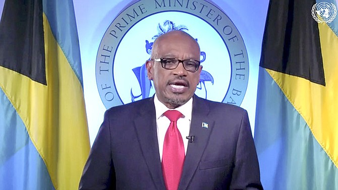 Prime Minister Dr Hubert Minnis speaks in a pre-recorded message which was played during the 75th session of the United Nations General Assembly, Saturday at U.N. headquarters. (UNTV via AP)
