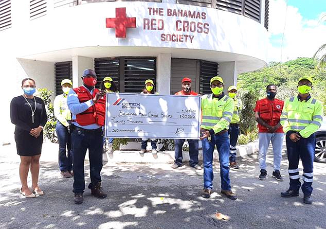 Country Manager, Rogelio Barahona (right), other employees of CEMEX Bahamas and Sean Brennen, director general accompanied by two representatives  of the Bahamas Red Cross Society stand in solidarity in the fight against hunger during COVID-19.