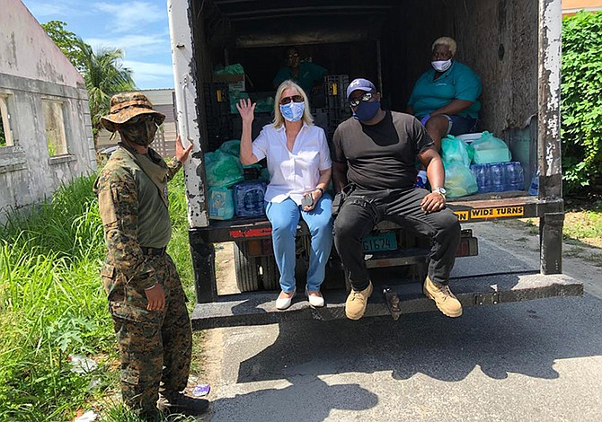 SALLY Van Touren and her team in action distributing food.