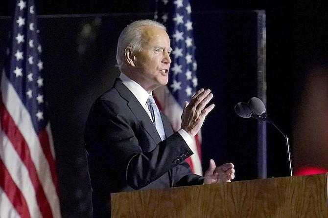 President-elect Joe Biden speaks in Wilmington, Del., Saturday. (AP Photo/Paul Sancya)