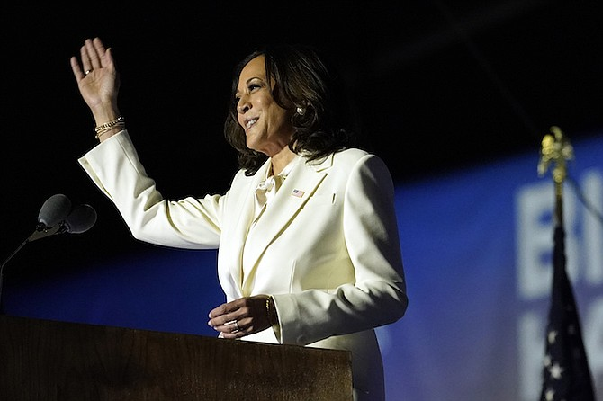 The story of American Vice President-elect Kamala Harris' victory has sparked renewed discussions about female Bahamian leaders and how high they can rise.  (AP Photo/Andrew Harnik)