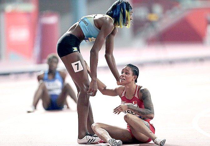 SALWA EID NASER, of Bahrain, right, reacts after winning the gold medal while being congratulated by silver medallist Shaunae Miller-Uibo, of the Bahamas, after the women's 400 metre final at the World Athletics Championships in Doha, Qatar, on Thursday, October 3, 2019.  (AP Photo/Nariman El-Mofty)