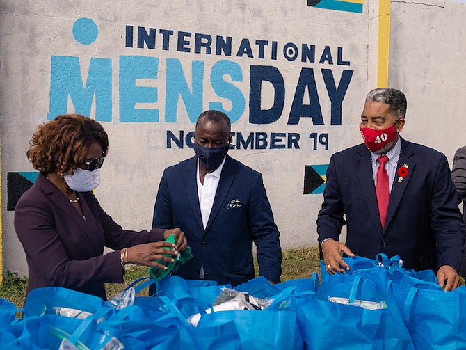 PATRICIA MINNIS, the wife of Prime Minister Dr Hubert Minnis, with Keith Cos, president of the International Men's Day organisation, centre, and Frankie Campbell MP. Photos: Donovan McIntosh