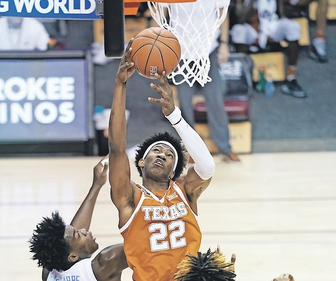 TEXAS forward Kai Jones (22), of The Bahamas, grabs a rebound over North Carolina forward Day'Ron Sharpe (11) in the first half of their NCAA college basketball game for the championship of the Maui Invitational yesterday in Asheville, N.C.  (AP Photo/Kathy Kmonicek)