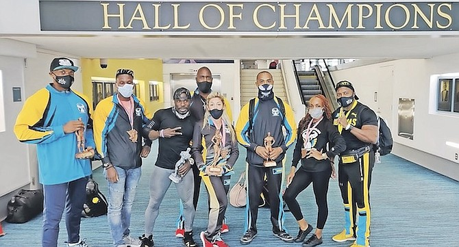 BACK HOME: Team Bahamas yesterday returned home from the 47th Central American and Caribbean Bodybuilding Championships over the weekend in Santo Domingo, Dominican Republic. Joel Stubbs, president of the Bahamas Bodybuilding and Fitness Federation, called it a gutsy performance from the team.