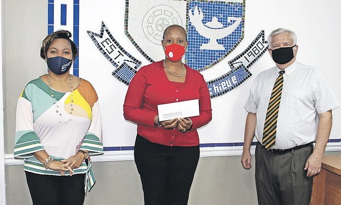 PICTURED left to right is BTVI's Dean of Student Services, Racquel Bethel; the Cancer Society of the Bahamas' administrator, Errin Storr, and BTVI's president, Dr Robert W Robertson. 
