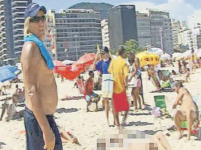 "PETER Nygard in this image from video in which he was seen walking on a Brazilian beach looking at women and saying to an interpreter to tell a young girl to ""lie about her age"". Photo: Mega Agency"
