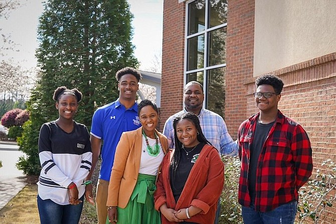 JORDAN STRACHAN, flanked by sister Amorie Strachan, mother Shuntay Strachan, sister Chelsea Strachan, father Sean Strachan and brother Christop.