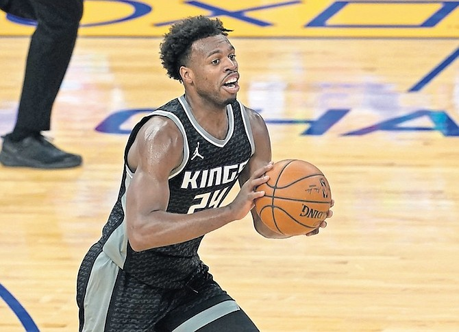 "SACRAMENTO Kings guard Chavano ""Buddy"" Hield in action against the Golden State Warriors in San Francisco on Monday night. Last night against the Bulls, he scored 10 points with three rebounds, three assists and a steal in 35 minutes. (AP Photo/Jeff Chiu)"