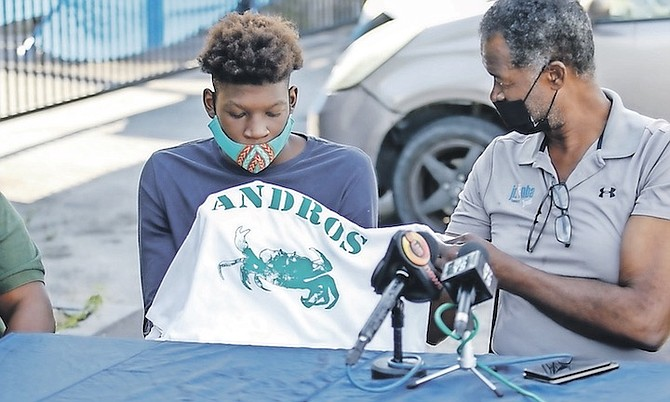 PETER Gilcud presents Fredrick King Jr with his Andros shirt.