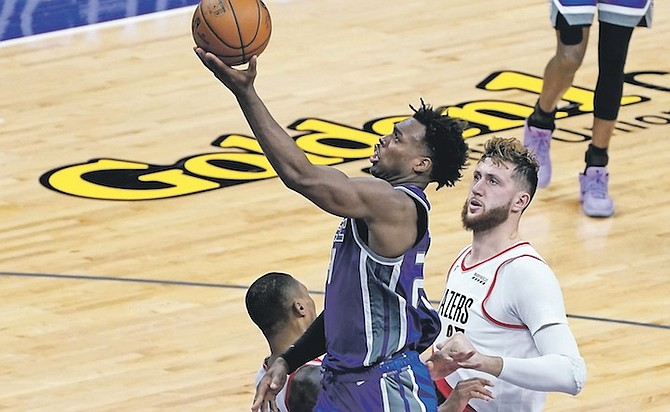 SACRAMENTO Kings guard Buddy Hield goes to the basket past Portland Trail Blazers centre Jusuf Nurkic, right, during the second half last night. The Trail Blazers won 132-126. Hield also posted five assists, six rebounds and a steal in 38 minutes. He shot 8-18 from three-point range.  (AP Photo/Rich Pedroncelli)