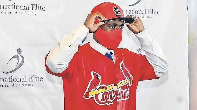 ADARI GRANT, of the Bahamas, officially became the newest member of the St Louis Cardinals organisation. He signed his contract to join the club among family and well wishers at the Pelican Bay Resort in Grand Bahama yesterday. Photos courtesy of 10th Year Seniors