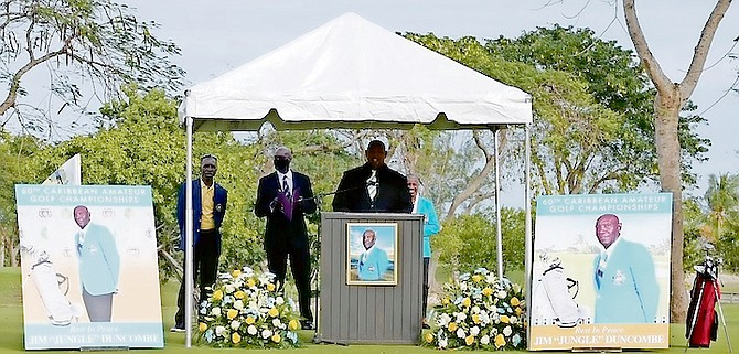 Pro golfer Keno Turnquest makes his remarks Saturday as fellow golfers and friends gathered at the Bahamas Golf Federation's Driving Range at the Baillou Hills Sporting Complex to pay their last respects to the late pro golfer and instructor James 'Jungle Jim' Duncombe.