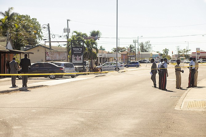 Police at the scene of the shooting on Village Road. Photo: Donavan McIntosh