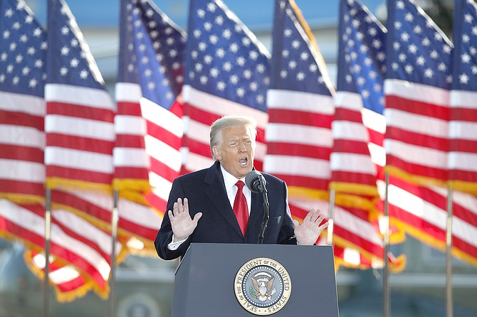 ON his last day as president, Donald Trump speaks to the crowd before boarding Air Force One at Andrews Air Force Base, Md., Wednesday.