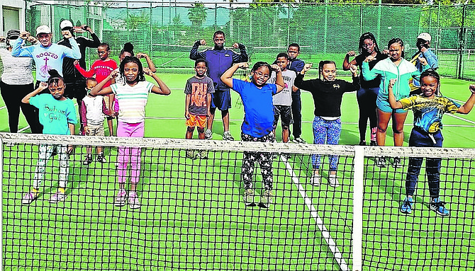 """PARTICIPANTS enjoy the Bahamas Lawn Tennis Association's """"Play Tennis"""" programme, featuring an introduction to the backhand stroke. Play Tennis has welcomed up to approximately 20 participants since its resumption at the beginning of the year, keeping in line with social distancing and safety protocols."""