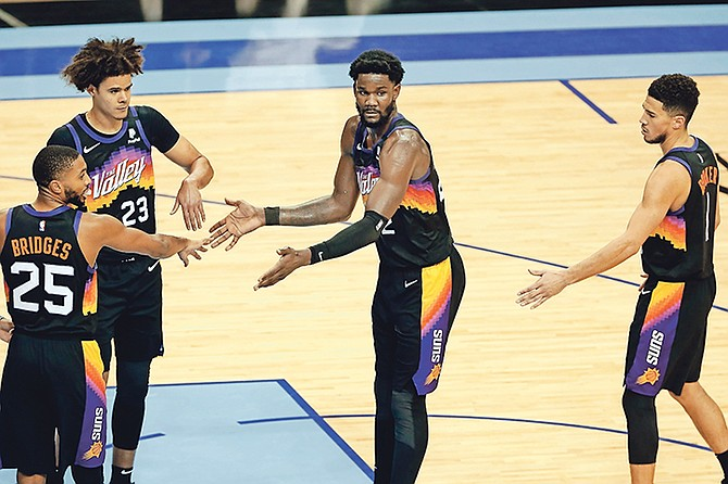 SEASON HIGH DOUBLE DOUBLE: Suns centre Deandre Ayton, far right, is congratulated by Mikal Bridges (25), Cameron Johnson (23) and Devin Booker (1), not in picture, after hitting a free throw during the second half against the Houston Rockets on Wednesday night in Houston.  (AP Photo/Michael Wyke)
