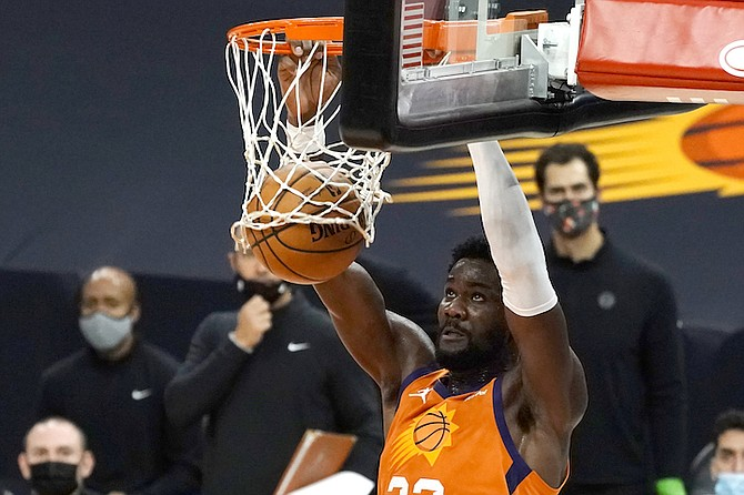 PHOENIX Suns centre Deandre Ayton (22) dunks during the second half against the Denver Nuggets on Friday in Phoenix. The Nuggets won 130-126. (AP Photo/Rick Scuteri)
