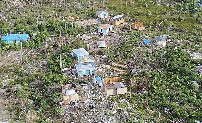 ONE of the issues residents are concerned about is new construction of shanty homes in the Farm Road area - pictured here last year.
