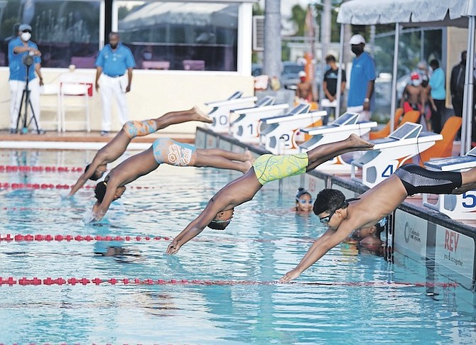 SWIMMERS compete in the Alpha Aquatics Invitational at the Betty Kelly-Kenning Aquatics Centre. More than a dozen swimmers attained the qualifying standards for the CARIFTA Games on Friday and Saturday. Photo: Terrel W Carey/Tribune Staff