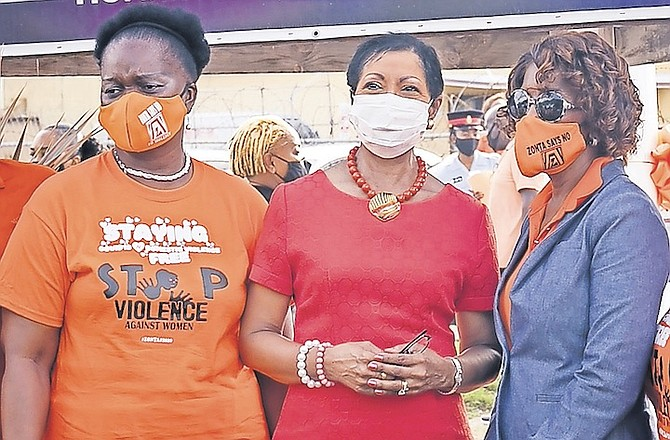 A CAUSE for all to support - Patricia Minnis and Ann Marie Davis, the wives of party leaders Dr Hubert Minnis and Philip Davis, along with Kim Moultrie, left, wife of the House Speaker, at a Zonta event in November calling for an end to violence against women.