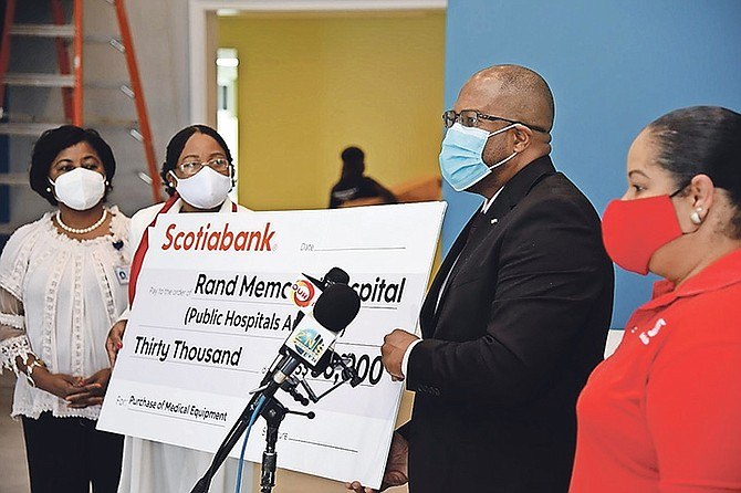 Scotiabank managing director Roger Archer presents a $30,000 cheque donation on Friday to the Rand Memorial Hospital in Grand Bahama. Mr Archer was also given a tour of the Paediatric Unit, which is under renovation. Photo: Preston Knowles Photography.