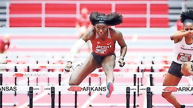 Charisma Taylor in action in the hurdles. Photo Walt Beazley