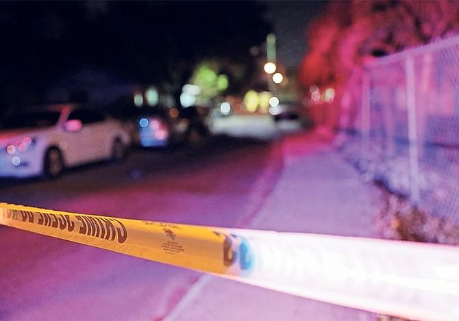 THE SCENE of last night's shooting. Photos: Donovan McIntosh/Tribune Staff