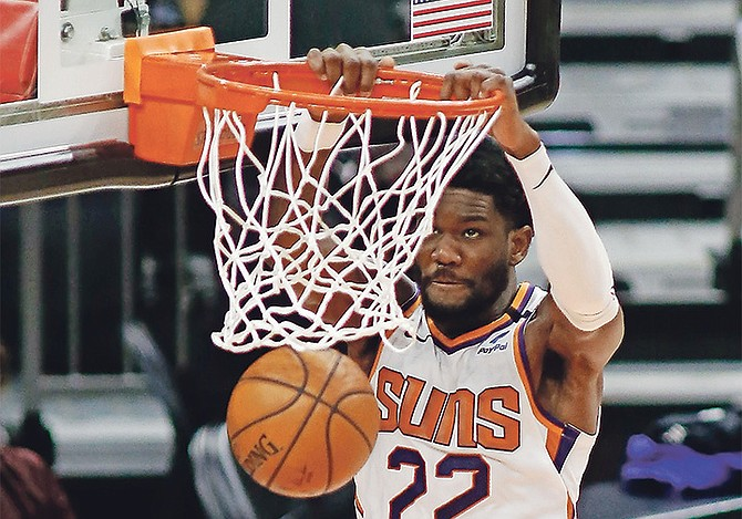 Phoenix Suns' Deandre Ayton slams one home against the Portland Trail Blazers during the first half last night in Phoenix.