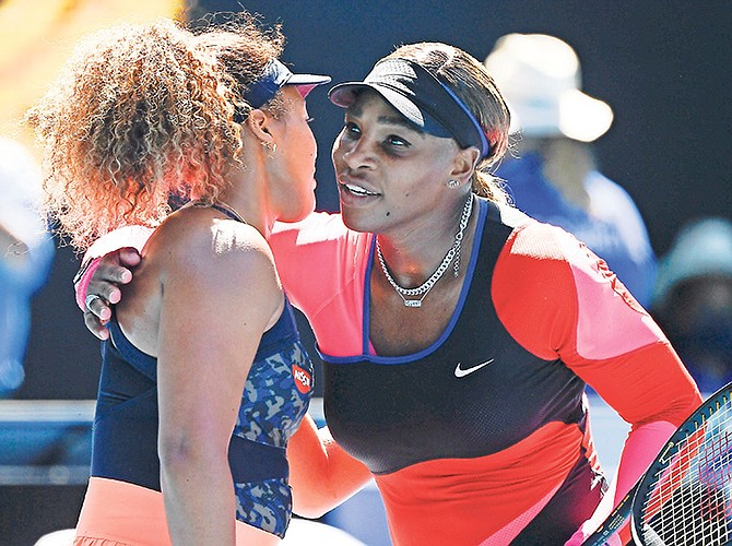 NAOMI OSAKA, left, is congratulated by Serena Williams, of the US, after Osaka won their semifinal match at the Australian Open tennis championship in Melbourne, Australia. Photo: Andy Brownbill/AP