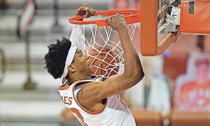 Texas forward Kai Jones dunks the ball during the first half of an NCAA college basketball game against Kansas Tuesday night in Austin, Texas. (AP Photo/Eric Gay)