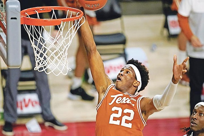 Texas forward Kai Jones drives to the basket against Iowa State on Tuesday night in Ames, Iowa. Texas won 81-67.