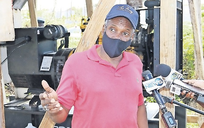 MINISTER of Works Desmond Bannister in The Farm shanty town in Abaco in February.