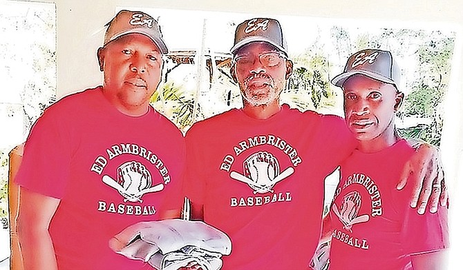 """IN this file photo, sponsor Ivan """"Showtime"""" Francis shares a moment with patron Ed Armbrister and co-ordinator Michael Butler of the Ed Armbrister Baseball League."""