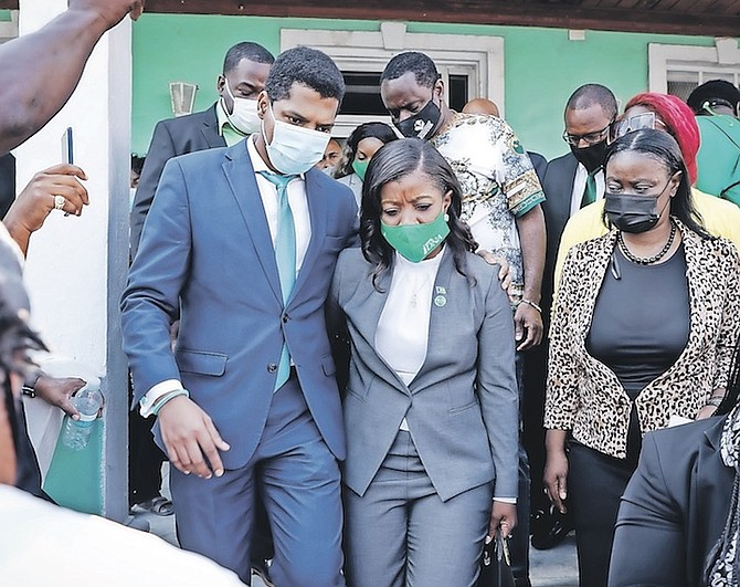EMMANUEL and Arinthia Komolafe exiting the police station. Photo: Racardo Thomas