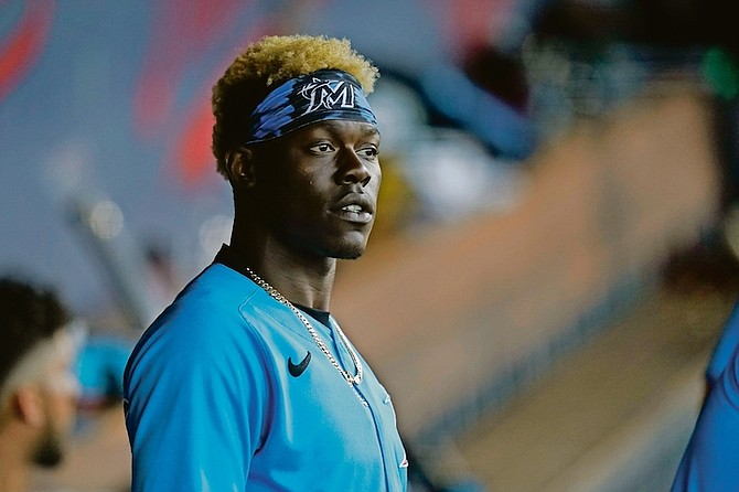 Miami Marlins second baseman Jazz Chisholm looks out from the dugout during a spring training baseball game against the Houston Astros on March 26 in West Palm Beach, Florida.  (AP Photos/Lynne Sladky)