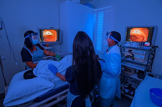 Dr Flloyd Carter performs a colonoscopy.