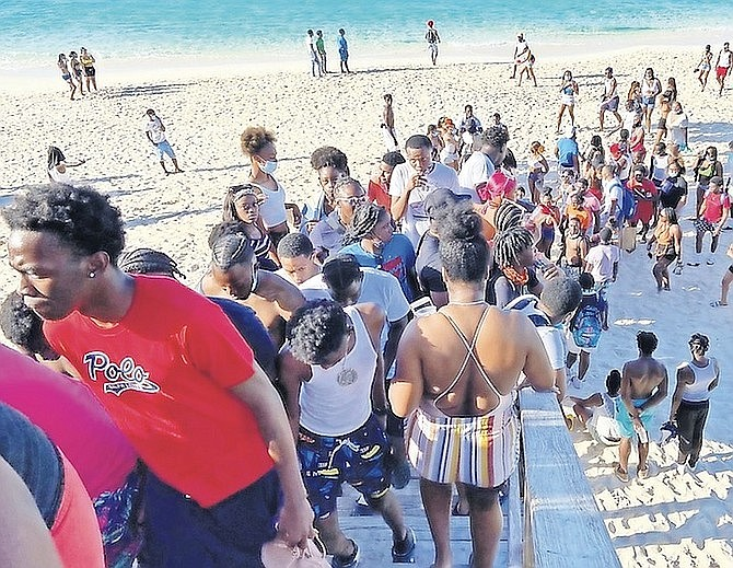 Scores of people packed at Cabbage Beach on Paradise Island on Sunday.