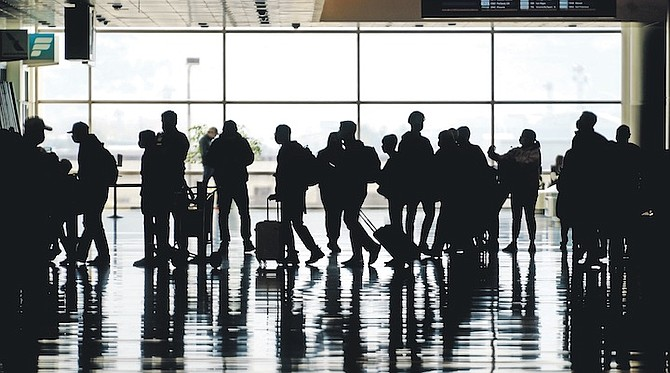 SILHOUETTES of travellers at Salt Lake City International Airport - as tourism is left a shadow of its former self in the US. Photo: Rick Bowmer/AP