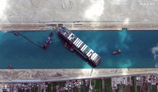 This satellite image from Maxar Technologies shows the cargo ship MV Ever Given stuck in the Suez Canal near Suez, Egypt, Sunday, March 28. (©Maxar Technologies via AP)