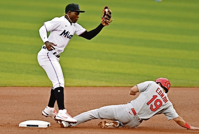 """ON THE REPLAY: St Louis Cardinals' Tommy Edman (19) steals second base as Miami Marlins second baseman Jasrado """"Jazz"""" Chisholm gets the throw during the first inning yesterday in Miami. Chisholm, who doubled for Miami's only extra-base hit, had a bases-loaded sacrifice fly.  (AP Photo/Jim Rassol)"""