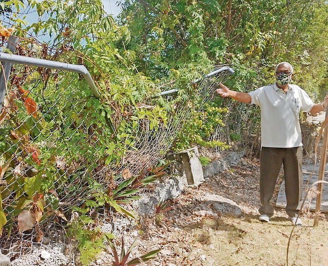 DR Alfred Brathwaite shows the damage to his property.